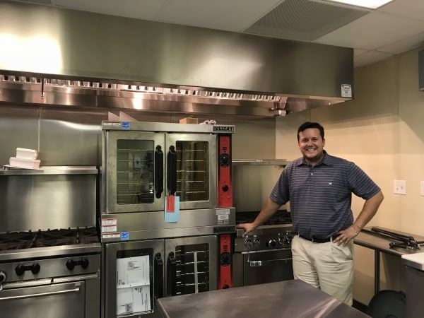 Local entrepreneur opens commissary kitchen space in historic building downtown to lower barrier of entry for culinary startups
